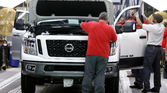 FILE- In this March 19, 2018, file photo technicians make final inspections to vehicles on the assembly line at the Nissan Canton Assembly Plant, in Canton, Miss. Nissan Motor Co. announced Thursday, Jan. 17, 2019, that it's cutting up to 700 contract workers at its Mississippi assembly plant, citing slowing sales for vans and Titan pickup trucks that it makes there. (AP Photo/Rogelio V. Solis, File)