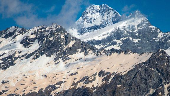 Glaciers in Mount Aspiring National Park on New Zealand's South Island have turned pinkish-red from dust and particles blown over from Australia's bush fires.