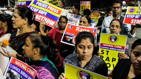 Protesters demand justice in the case of a veterinarian who was gang-raped and killed, during a demonstration in Kolkata.