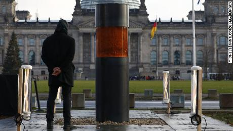 The urn stands in a memorial erected by the Center for Political Beauty opposite the German parliament.
