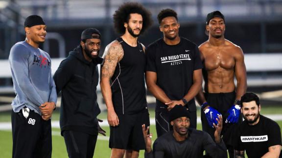 Colin Kaepernick stands with Bruce Ellington, Brice Butler, Jordan Veasy, and Ari Werts during Kaepernick's workout held at Charles R. Drew High School on November 16 in Riverdale, Georgia.