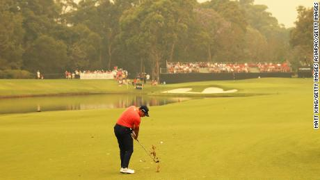 Sergio Garcia plays a shot in hazy conditions at the Australian Open.