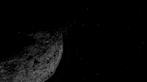 Particles can be seen releasing from the asteroid.