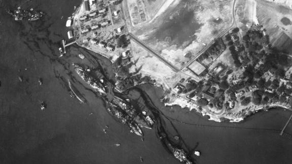 An aerial view of the harbor shows the destruction of the USS California, the USS Maryland, the USS Oklahoma, the USS Tennessee, the USS West Virginia and the USS Arizona.