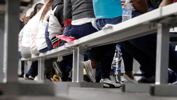 Migrants who are applying for asylum in the United States go through a processing area at a new tent courtroom at the Migration Protection Protocols Immigration Hearing Facility, Tuesday, Sept. 17, 2019, in Laredo, Texas.
