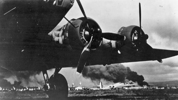 A US Army aircraft lands at Hickam Field on December 7. The base sustained heavy losses during the attack.