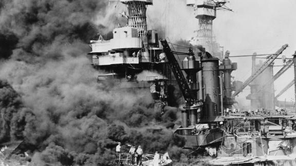 A rescue boat retrieves a seaman from the burning USS West Virginia after the Japanese attacked Pearl Harbor on December 7, 1941.