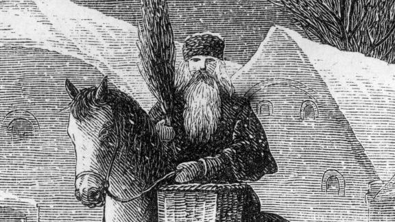 circa 1850:  Engraving of St Nicholas carrying a tiny Christmas tree in a basket while riding a horse past houses in the snow, mid-to-late nineteenth century.  (Photo by Hulton Archive/Getty Images)