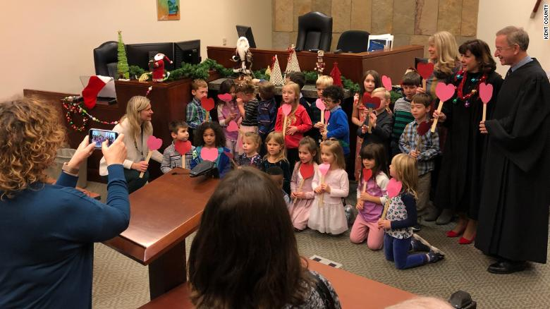 Mrs. McKee's kindergarten class supported their classmate as his adoption was finalized.