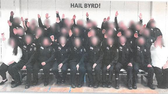 A number of employees of the West Virginia Division of Corrections and Rehabilitation have been suspended surrounding the investigation of a photograph showing a correctional officer training class performing the Nazi salute.