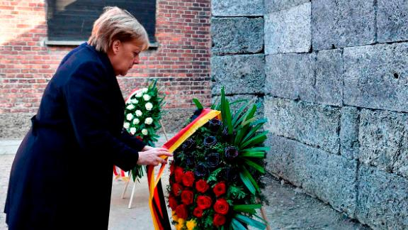 While pays her respect at the Auschwitz memorial.