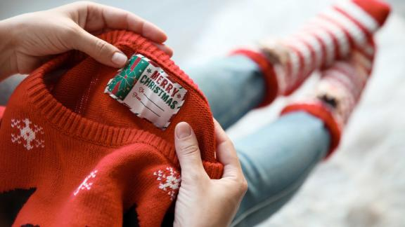 A UK charity has warned of the environmental harm caused by novelty Christmas sweaters, which contain high levels of plastic.