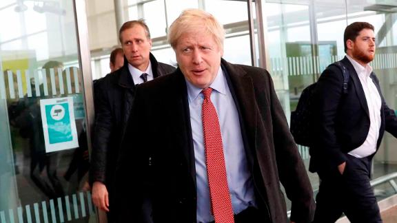 UK Prime Minister Boris Johnson arrives at a train station in Kent while campaigning on Friday.