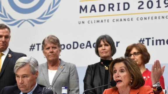 House Speaker Nancy Pelosi and Senator Sheldon Whitehouse answer questions last week during the UN's COP25 in Madrid.