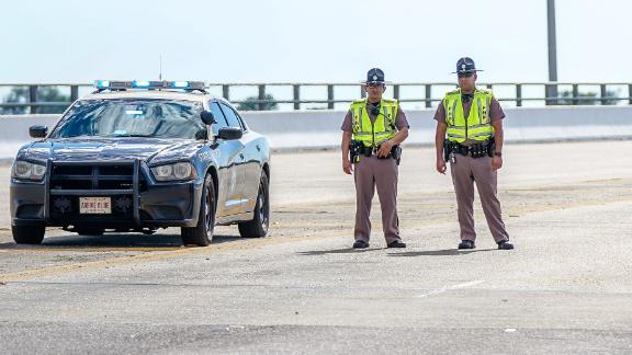 PENSACOLA, FLORIDA - DECEMBER 06: Florida State Troopers block traffic over the Bayou Grande Bridge leading to the Pensacola Naval Air Station following a shooting on December 06, 2019 in Pensacola, Florida. The second shooting on a U.S. Naval Base in a week has left three dead plus the suspect and seven people wounded.  (Photo by Josh Brasted/Getty Images)