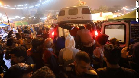 An ambulance arrives in Tahrir Square after gunmen opened fire on anti-government protesters.