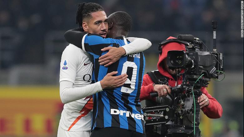 Smalling (left) and Lukaku (right) embrace ahead of Friday's Serie A game in Milan.