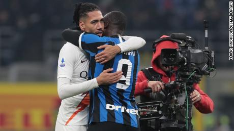 Chris Smalling of AS Roma embraces Romelu Lukaku of FC Internazionale. Smalling and Lukaku played for Manchester United last season.