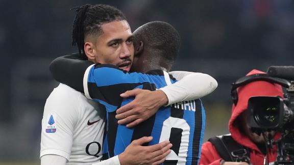 Chris Smalling of AS Roma embraces Romelu Lukaku of FC Internazionale. Smalling and Lukaku played for Manchester United last season.