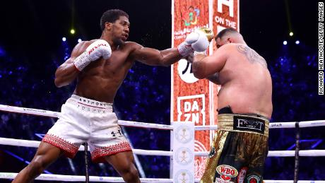 Anthony Joshua punches Andy Ruiz Jr. during their title fight in Saudi Arabia on Saturday.