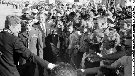 President John F. Kennedy greets crowds at Castle Air Force Base in California in August 1962. Secret Service agent Winston Lawson stands behind the left shoulder of  Brig. Gen. William R. Yancey.