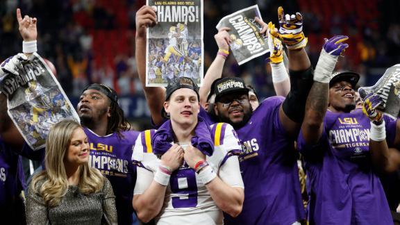 LSU quarterback Joe Burrow (9) celebrate with teammates after the Southeastern Conference championship NCAA college football game against Georgia, Saturday, Dec. 7, 2019, in Atlanta. LSU won 37-10. (AP Photo/John Bazemore)