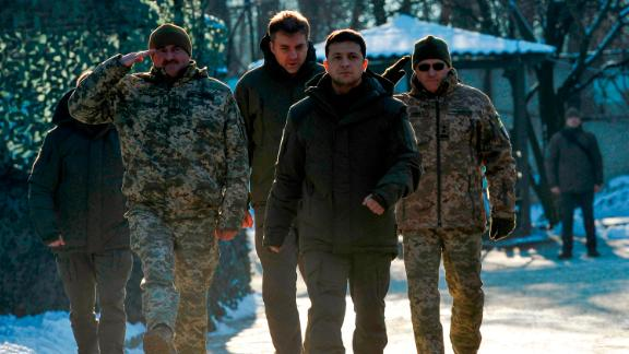 Ukrainian President Volodymyr Zelensky meets with servicemen while visiting the Donetsk region on December 6, 2019. - President Zelensky on December 6 visited frontline troops fighting Moscow-backed separatists in the country's east a few days before crucial talks on the conflict with Vladimir Putin. (Photo by Evgeniya MAKSYMOVA / AFP) (Photo by EVGENIYA MAKSYMOVA/AFP via Getty Images)