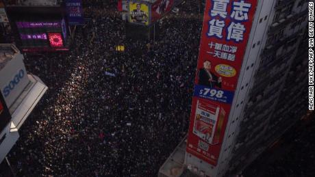 "People crowd roads in the Causeway Bay area as they take part in a pro-democracy rally from Victoria Park to Chater Road in Hong Kong on December 8, 2019. - Hong Kong democracy protesters are hoping for huge crowds December 8 at a rally they have billed as a ""last chance"" for the city's pro-Beijing leaders in a major test for the six-month-old movement. (Photo by Alastair Pike / AFP) (Photo by ALASTAIR PIKE/AFP via Getty Images)"