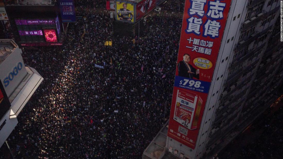 Hong Kong protesters keep up pressure with mass march thumbnail