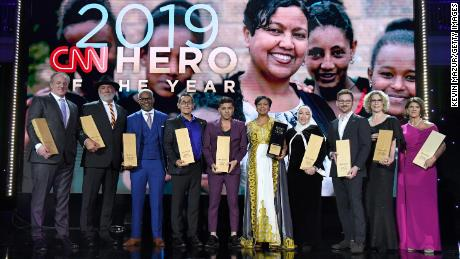 NEW YORK, NEW YORK - DECEMBER 08: (L-R) The Top 10 2019 CNN Heroes Woody Faircloth, Mark Meyers, Richard Miles, Roger Montoya, Afroz Shah, Freweini Mebrahtu, Najah Bazzy, Zach Wigal, Mary Robinson, and Staci Alonso pose during CNN Heroes at American Museum of Natural History on December 08, 2019 in New York City. (Photo by Kevin Mazur/Getty Images)