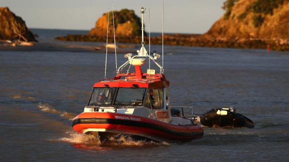 Coastguard rescue boats arrive at a marina near Whakatane on December 9.