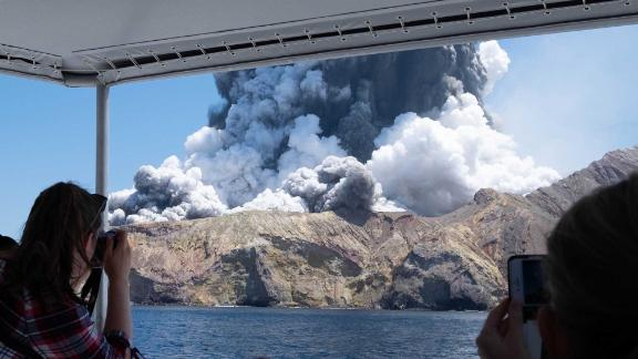 Michael Schade, a visitor to the island, captured this photo from a boat, moments after the eruption began.