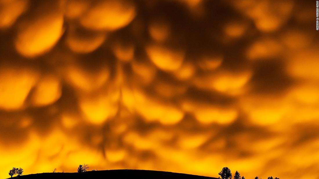 Mammatus clouds -- formed when downward currents collide with rising warm air -- seen after a sunset in Wyoming, USA.