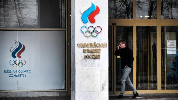 A man walks in front of the Russian Olympic Committee (ROC) headquarters in Moscow on December 6, 2019. - The executive committee of the World Anti-Doping Agency will meet in Lausanne on December 9 to consider a recommendation for the ban, which would exclude Russians from major sports events including the 2020 Tokyo Olympics and 2022 Beijing Winter Olympics. A WADA review panel has accused Moscow of falsifying laboratory data handed over to investigators as part of a probe into the doping allegations that have plagued Russia for years. (Photo by Alexander NEMENOV / AFP) (Photo by ALEXANDER NEMENOV/AFP via Getty Images)