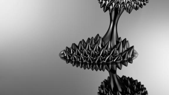 Ferrofluids shapeshift under the magnetic field created by two rare-earth disc magnets.