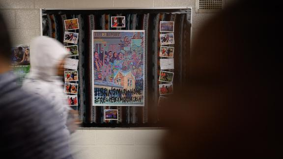 A bulletin board dedicated to Mario Aguilar hangs in the hallway at Wilbur Cross High School in New Haven, Connecticut. Since ICE detained Aguilar in September, students, teachers and administrators at the school have been pushing for his release.