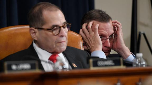 House Judiciary Committee ranking member Rep. Doug Collins, R-Ga., right, and House Judiciary Committee Chairman Rep. Jerrold Nadler, D-N.Y., left, listen as Democratic staff attorney Daniel Goldman and Republican staff attorney Steve Castor testify as the House Judiciary Committee hears investigative findings in the impeachment inquiry of President Donald Trump, Monday, Dec. 9, 2019, on Capitol Hill in Washington.(AP Photo/Susan Walsh)