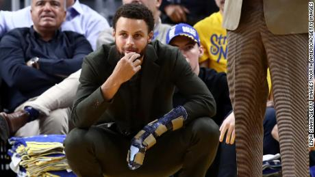 Steph Curry watches from the sidelines as Golden State loses to Oklahoma City Thunder in November.