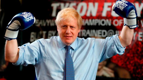 "Boris Johnson wears boxing gloves emblazoned with ""Get Brexit Done"" during a stop in Manchester in late November."