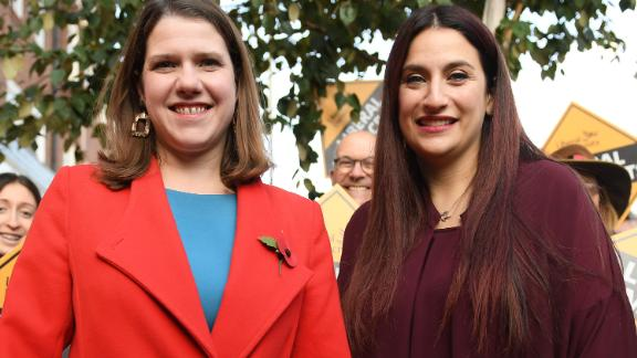 Liberal Democrats leader Jo Swinson, left, is greeted by the party
