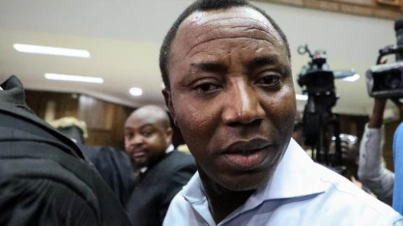 "Convener of ""#Revolution Now"" Omoyele Sowore arrives at the courtroom during his arraignment for charges against the government at the Federal High Court in Abuja, on September 30, 2019. - Nigeria's high court ordered on September 30, 2019,  a former presidential candidate remanded in custody after he was charged with plotting treason over calls for a ""revolution"" in the West African nation. Omoyele Sowore, a fierce critic of President Muhammadu Buhari, has been held since August by the Department of State Services (DSS) secret police after urging protests under the online banner ""#RevolutionNow"". (Photo by KOLA SULAIMON / AFP)        (Photo credit should read KOLA SULAIMON/AFP via Getty Images)"