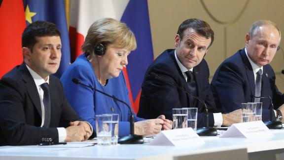 (FromL) Ukrainian President Volodymyr Zelensky, German Chancellor Angela Merkel, French President Emmanuel Macron and Russian President Vladimir Putin give a press conference after a summit on Ukraine at the Elysee Palace, in Paris, on December 9, 2019. - Leaders aim for new withdrawal of forces from Ukraine conflict zones by March 2020, according to a communique on December 9, 2019. (Photo by LUDOVIC MARIN / POOL / AFP) (Photo by LUDOVIC MARIN/POOL/AFP via Getty Images)
