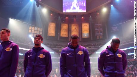 Los Angeles Lakers star LeBron James (second from right) and former Lakers forward Lance Stephenson (right) bow their heads during the National Anthem before the game against the Portland Trail Blazers on November 14, 2018.