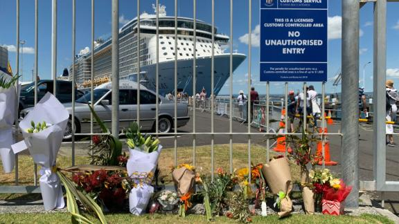 A makeshift memorial is seen in front of cruise ship Ovation of the Seas, in Tauranga, New Zealand, December 10. There were believed to be at least 30 passengers from the ship taking a tour of the island when the eruption took place.