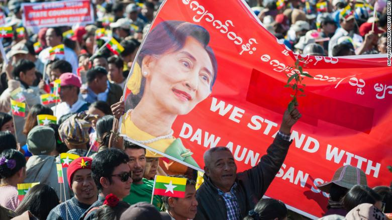 People rally in support of Myanmar State Counsellor Aung San Suu Kyi in Yangon ahead of her appearance at the International Court of Justice.