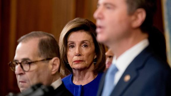House Speaker Nancy Pelosi of Calif., center, and Chairman of the House Judiciary Committee Jerrold Nadler, D-N.Y., left, listen as Adam Schiff, D-Calif., Chairman of the House Intelligence Committee, foreground, speaks during a news conference to unveil articles of impeachment against President Donald Trump, abuse of power and obstruction of Congress, Tuesday, Dec. 10, 2019, on Capitol Hill in Washington.