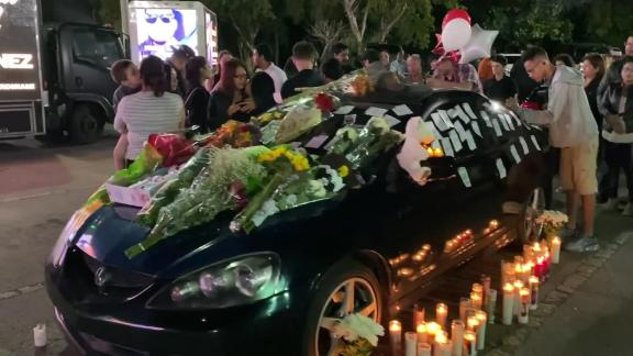Mourners place notes and flowers on Frank Ordonez's car on Sunday, three days after he was killed in a shootout after his UPS truck was hijacked. He'd parked the car outside a UPS facility in Doral, Florida.