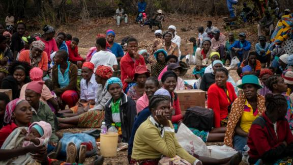 A crowd waits for food aid distribution to begin in Kasibo, Zimbabwe.