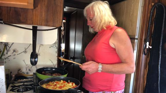 Megan Sue Belafonte prepares breakfast in an RV.