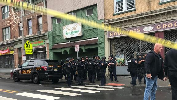A police officer, three civilians and the two suspects were killed in the shooting, authorities said.